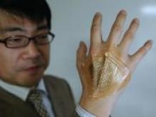 Японские инженеры создали дисплей-пластырь - «Новости Банков»