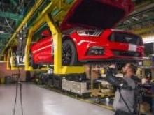 Работники заводов Ford получат экзоскелеты - «Новости Банков»